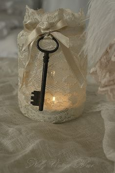 nelly vintage home: Decorative jars (mason jar covered in lace) could hang father christmas door keys on them