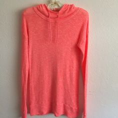 Roxy Coral-Colored Lightweight Knit Hoodie Roxy Lightweight Knit Hoodie in Soft Coral Salmon Color. Can be worn over a tank or camisole with jeans or leggings Or even as a beach coverup Roxy Tops Sweatshirts & Hoodies Soft Corals, Salmon Color, Lightweight Jacket, Hoodies, Sweatshirts, Roxy, Camisole, Cover Up, Leggings