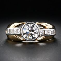 This chic and shining diamond ring, or engagement ring, from the City of Light, is beautifully handcrafted in platinum and rich 18 karat yellow gold. A bright and glistening 1.10 carat European-cut diamond is tube set in platinum and embellished on each side by a shimmering row of five square step-cut diamonds in an artfully sculpted mounting with a combination of late-Art Deco and Retro design touches. A dazzling and distinctive vintage jewel, circa 1930s-1940s. French gold and platinum…