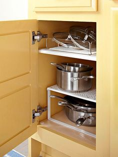 Add an extra level of storage to a cupboard by popping in a riser. | 29 Things You Can Do Right Now To Get Your Kitchen Organized