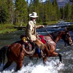 A modern cowboy crossing a stream on his horse. A modern cowboy crossing a stream on his horse. Western Riding, Trail Riding, Western Art, Horse Riding, Cow Girl, Cow Boys, Cowgirl And Horse, Cowboy And Cowgirl, All The Pretty Horses