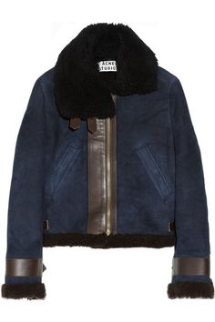 Midnight-blue shearling Black shearling collar, brown leather trims, two concealed snap-fastening slant pockets, buckle-fastening cuffs and tabs Zip fastening through front 100% shearling (Lamb); trim1: 100% shearling (Lamb), trim2: 100% leather (Lamb) Specialist clean