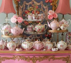 An updated version of this image.  Vintage pink and gold teapots, cake stands and general frou frou.