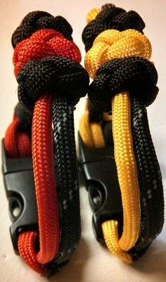 Paracord Survival Bracelets. Simple design with paracord beads and safety whistle buckle.