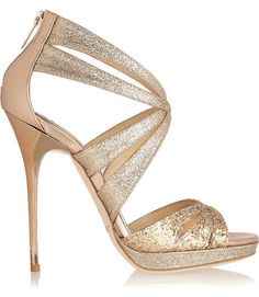 Heel measures approximately 125mm/ 5 inches with a 10mm/ 0.5 inch platform. Let Jimmy Choo's shimmering leather sandals inject your favorite looks with instant glamour. Style them with cropped pants and watch the dazzling glitter-finish turn heads at every event. #shoes #footwear #glitter #fashion #heels