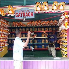 Coastline Cat Rack: Players have three chances to knock down the standing props off their paws! Knock down 2 cats for a small prize. Knock down 3 cats for a large prize.    Visit the Pacific Park website at www.pacpark.com