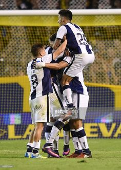 Emanuel Reynoso of Talleres celebrates with teammates after scoring the second goal of his team during a match between Boca Juniors and Talleres as part of Torneo Primera Division 2016/17 at Alberto J Armando Stadium on March 12, 2017 in Buenos Aires, Argentina.