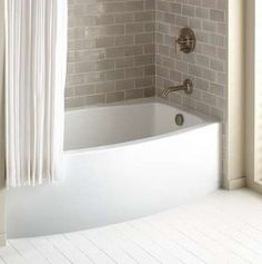 """Supersize Your Small Bath with These 8 Pro Tips  -  Aim for Average  """"A too-big tub is a real space waster,"""" says Lamarre. """"Most people sit upright in the tub, so a 5-foot tub is sufficient for practically everyone. There are all kinds of ways to use the space that you save with a smaller tub,"""" such as adding a mini storage unit. """"The more you can build in, the better."""