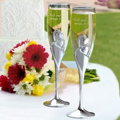 Breathtaking Swarovski crystals accent a romantic heart design on these champagne toasting flutes offered by Exclusively Weddings.