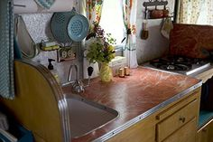 Would like to put a bigger sink in ours - big enough to wash actual dishes.  Haha. And I like this color countertop.