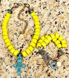 Bold and Vivid Yellow Statement Necklace and Bracelet Necklace: $150 Bracelet: $125 Simple, yet bold, this necklace and bracelet set will make your outfit! Just throw on a basic piece and these do the rest! I have these fantastic glass beads in cobalt, bright red and baby blue too. These are not yet on my website, so text me if you are interested: kelly@xogallery.com