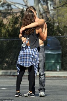 Ready to rumba: Derek Hough and Hayley Erbert are cementing themselves as Dancing With The Stars cutest lovebirds as they snuggled their way through a work day in Los Angeles, California, on Monday