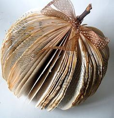 Make an Autumn pumpkin out of an old book.  I'm thinking that maybe finishing this project with some hairspray may help it hold its shape...