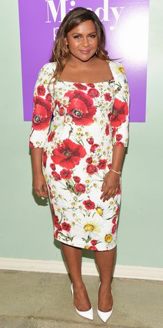 830ba8c1648558 Mindy Kaling in a poppy-strewn Dolce   Gabbana sheath dress