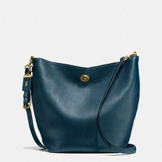 Coach Duffle Shoulder Bag ($550) ❤ liked on Polyvore featuring bags, handbags, shoulder bags, crossbody purses, blue crossbody, cross-body handbag, blue crossbody handbag and blue handbags