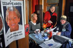 Preparing missing child posters for the one-year anniversary vigil for Jaliek Rainwalker, are from left, volunteer Deirdre Barry of Schaghticoke, Jaliek's maternal grandmother Barbara Reeley of Wynantskill and Jaliek's foster mother from 1997-1999, Joy Purdy of Albany, in Greenwich Thursday morning October 30, 2008. (John Carl D'Annibale / Times Union) Photo: John Carl D'Annibale / 00000990A