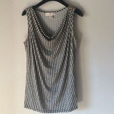 Michael Kors: scoop neck tank Rayon/spandex blend. Generous cut so will fit small too. Cowl neck. Metal detail on shoulder. Great under suit. Excellent condition. MICHAEL Michael Kors Tops Tank Tops