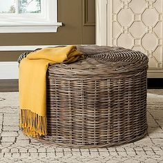 The Jesse Wicker Storage Coffee Table from Safavieh is the perfect blend of form and function. This lovely round table has a cotton-lined interior, ideal for storing away any clutter. A wonderful and practical accent piece for any room.