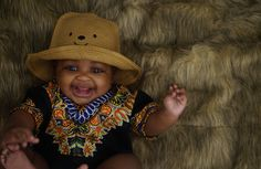 Baby in a black dashiki handmade in the US for babies and toddlers.