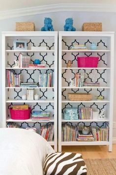 Adding wallpaper to the backboard of a bookcase creates a really cool graphic. Also love the black and white aesthetic, with pops of electric pink and blue.