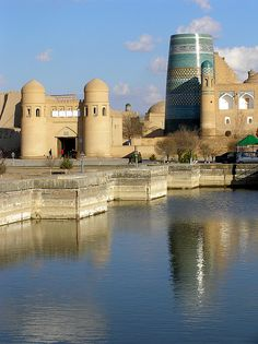 Tichan-Kala fortress - former royal court of Khiva, the walled city on the old Silk Road. Legend has it that the city was formed by Shem, son of Noah. Islamic World, Islamic Art, Islamic Architecture, Art And Architecture, Places Around The World, Around The Worlds, Silk Road, Central Asia, Asia Travel