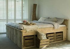 DIY Pallet Bed with crates for storage -- I like the crate idea for the space in our half walls, yes??