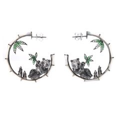 Probably not really an ideal beach accessory, but definately on the want list anyway.    Fantasie Panda's Rest Earrings by Annoushka