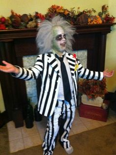 Beetlejuice! Beetlejuice! Beetlejuice! Easy Halloween costume, black suit paint white stripes, purchased bald head with hair, used green, black, and white face paint. I glued fake roaches on the suit. And added a zagnut candy bar in the pocket;-) it was a funny costume for my 6 yr old.