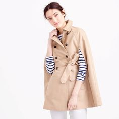 56d5df1b34f The classic trench coat meets the cape. Crafted in water-resistant cotton,  this piece features a half gingham lining, a flattering waist-cinching belt  and ...