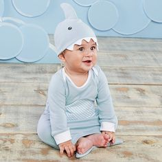 """Have you ever seen a shark this cuddly soft? Once baby puts on this baby blue shark themed night gown and cap, he'll be ready to """"Let The Fin Begin""""! 