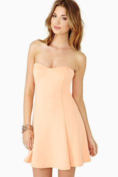 Color code your closet with this bright orange skater dress featuring a sweetheart neckline and seamed detailing. Stretch fabric, lined at t...