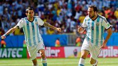 Angel Di Maria celebrates with goal scorer Gonzalo Higuain.