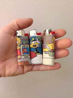 3 brand new custom Simpsons BIC mini lighters by bitchnug on Etsy
