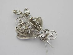"""Sterling Silver Vintage Rhinestone Brooch. 2 1/2"""" long with prong set rhinestones and filigree stamped """"Sterling LG"""" and weighing 9.4 grams.   Beautiful for a bride or mother of the bride!   Shop this product here: http://spreesy.com/blingitaround/12   Shop all of our products at http://spreesy.com/blingitaround      Pinterest selling powered by Spreesy.com"""