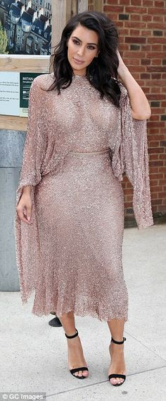 All that glitters: Kim sparkled from head to toe in the showstopping gown that she teamed ...