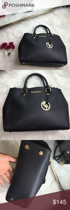 MICHAEL MICHAEL KORS DOUBLE ZIP TOTE JET SET TRAVL Designed with the signature details of the Jet Set Travel line and adorned with the Michael Kors bag charm, this double zip tote will add instant glamour to your working-girl look. This is in very good pre loved condition. Missing the shoulder strap. The arm straps/handle have a little scuffing and wear. See pic! MICHAEL Michael Kors Bags Travel Bags