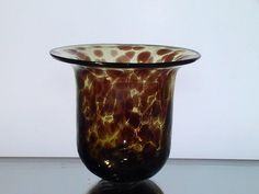 Hanging Candle Holder Bowl Leopard Print 4.25 x 4.75 Amber Glass   Replacement glass bowl candle holder, shaped to fit into metal type ringed holders for candles. Hand blown, clear, and flat brim. Heavy mottled glass in amber with dark brown spots. Color is baked into the glass. Measures approximately 4.25 x 4.75 and can vary up to 1/8 inch in size. Fits in rings that measure 3.75 inches. (Inside Measurements)
