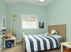 sea-glass green — like Benjamin Moore's Palladian Blue HC-144 and Sherwin-Williams' Sea Salt 6204