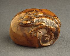 Mitani Goho (style of) (Japan)   Lizard on Chestnut, late 18th-early 19th century  Netsuke, Wood with inlays. LACMA