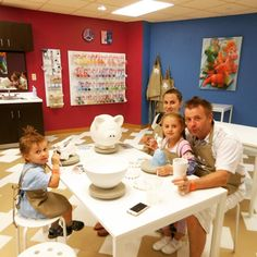 "Awesome family time! They painted ""Family Savings"" on the XL Piggie Bank...I wonder how much money you can fit in there!?"