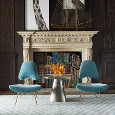 It's an ad for the lucite amoeba..but I'm LOVING the book stacked in the fireplace!!