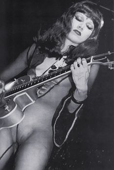I guess it doesn't really matter if The Cramps' Poison Ivy was a great guitarist or not ... because she had attitude to spare.