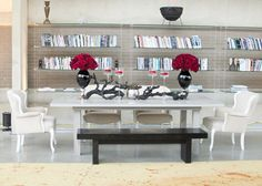 drift wood mixed with soft roses. Floral by Blue Vanda Designs. Table, bench and chairs by AFR Event Furnishings