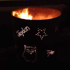 Barrel fire pit with stenciling