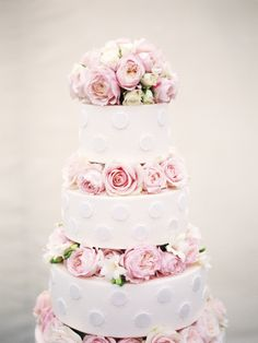Pretty rose topped cake: http://www.stylemepretty.com/2013/11/01/london-wedding-from-polly-alexandre/ | Photography: Polly Alexandre - http://alexandreweddings.com/