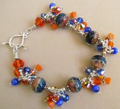 Lampwork Beaded Charm Bracelet, orange and Blue, University of Florida, Handmade by Harleypaws by Harleypaws on Etsy https://www.etsy.com/listing/211922910/lampwork-beaded-charm-bracelet-orange