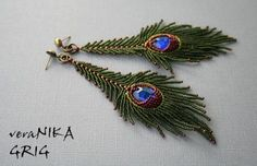 Happy Feather earrings - Feathers series by Russian artist veraNIKA. I think she did a good job of rendering the peacock feathers in this piece.