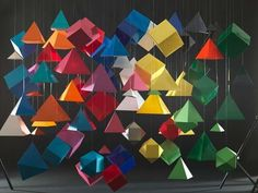 Romain Lenancker loves using paper origami to create his photography, and uses brightly colored papers to make them even more exciting.  Romain Lenancker's origami photography involves lots of folded paper origami that in itself is pretty but nothing too dramatic, but when in mass amounts and photographed with an eye like Romain Lenancker becomes bold art. A very cool collection of images from the photographer, who clearly has a patience for folding paper.