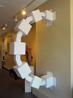 "foo bar by Mark Lorah. Cardboard boxes. On display at the ""Off the Wall"" exhibit at Studio Place Arts in Barre, VT"