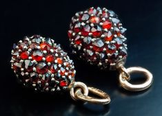 Unusual Antique Russian Miniature Egg Pendants, St. Petersburg, 1904 - 1908, by Ivan Britzin. Silver egg pendants with 14K gold rings, pavé set with rose cut red Bohemian garnets.